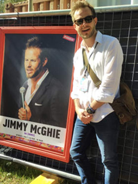 Jimmy standing beside his poster
